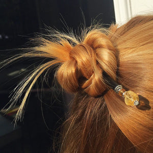 A blonde woman wears a half bun using the Layla Hair Stick made from Yellow Citrine nugget beads.