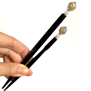 The standard and large sizes of our Lindsey Hair Stick made from a silver Czech glass bead
