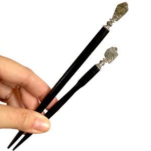 The standard and large sizes of our Palmer Hair Stick made from black rutile quartz stone.