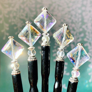 Five of the Penelope Tidal Hair Sticks made from iridescent clear glass beads.