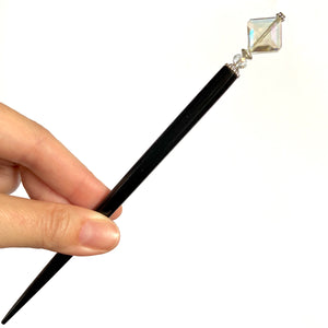 The large size of the Penelope Tidal Hair Stick made from iridescent clear glass beads.