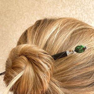 A messy bun style using a Quinn Tidal Hair Stick