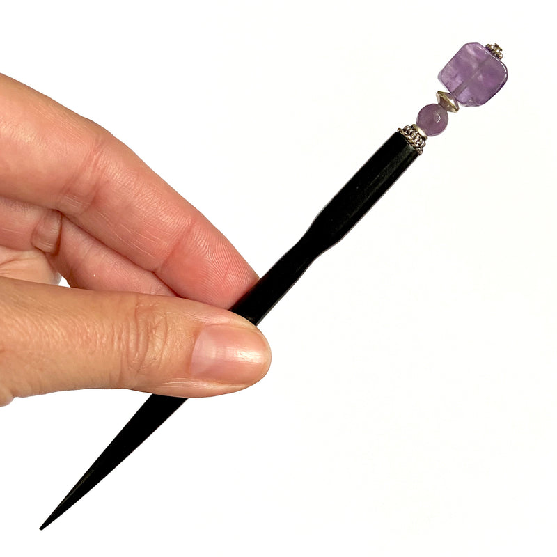 A close up of our Violet Hair Stick made from natural amethyst stone.