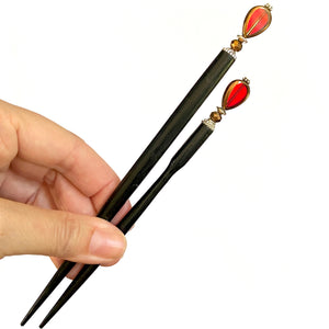 The standard and large sizes of our Reina Hair Stick made from a red Czech glass bead with bronze edging.