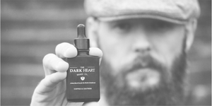 Bearded Gentleman Holding Dark Heart Beard Co Oil