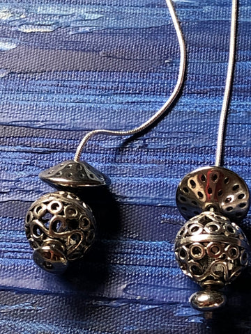 silver laminated finish pendant balls on long snake rope chain.
