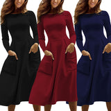 Autumn and winter long-sleeved solid color round neck zipper pocket dress