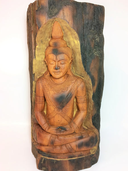 Display Buddha Carved in Tree Trunk