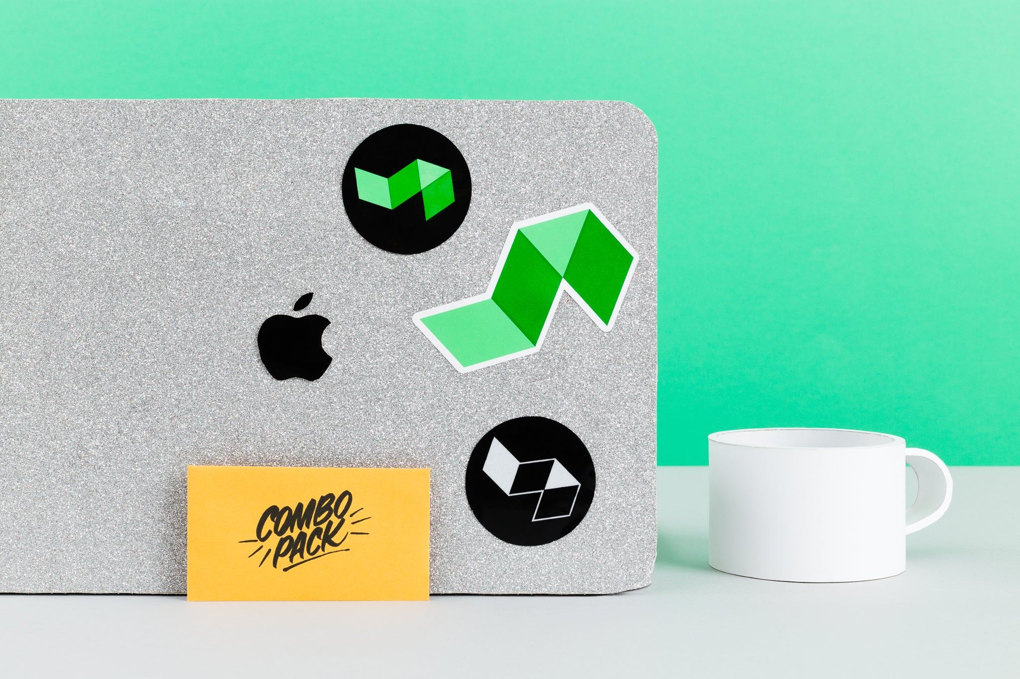 1 die-cut logo sticker, one black/green circle sticker, one black/silver circle sticker, shown on desk