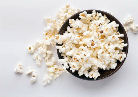 Foods that contain trans fats such as pop corn are high in cholesterol