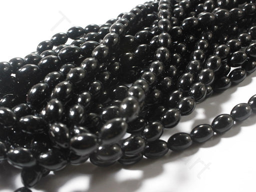 Black Oval Pressed Glass Beads