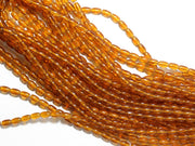 Golden Oval Pressed Glass Beads