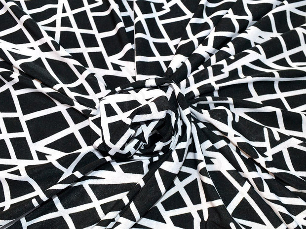 Black Geometrical Design Polyester Lycra Single Jersey Fabric | The Design Cart