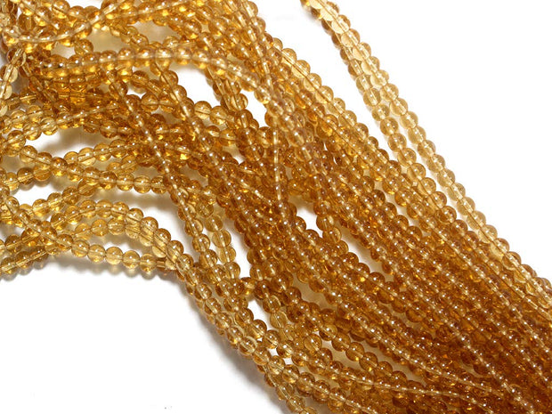 Golden Round Pressed Glass Beads