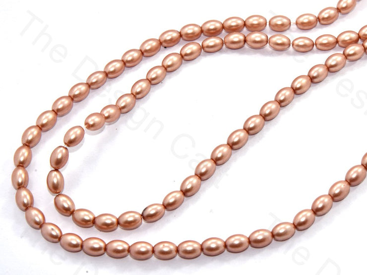 Light Golden Oval Shaped Glass Pearl | The Design Cart