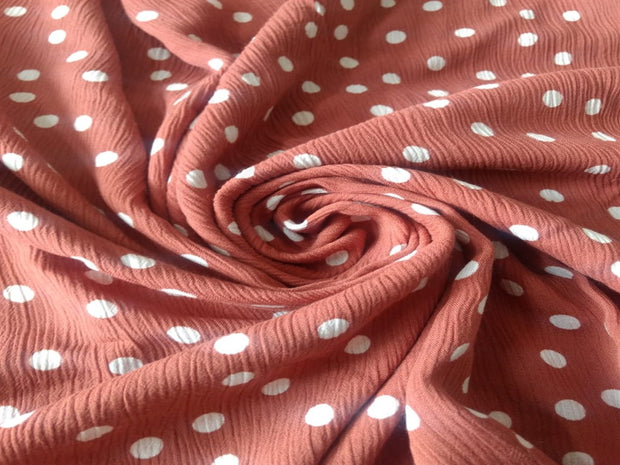 Ash Pink Polka Dots Crinkle Rayon Fabric | The Design Cart