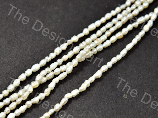 Cream Pebble Shaped Mother Of Pearl Stones