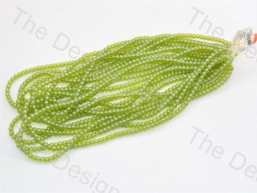Green Round Pressed Glass Beads Strings - The Design Cart