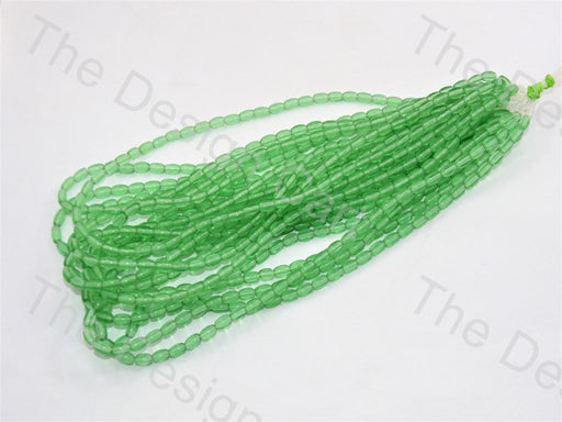 Sea Green Oval Pressed Glass Beads Strings - The Design Cart