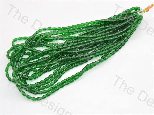 Dark Green Oval Pressed Glass Beads Strings - The Design Cart