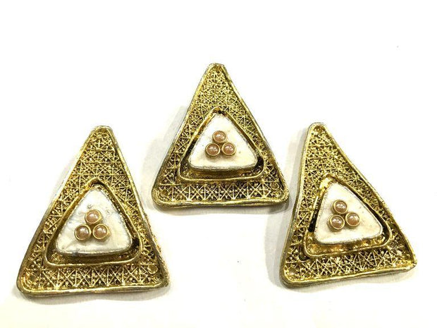 Golden Triangular Metal Piece With White Enamel