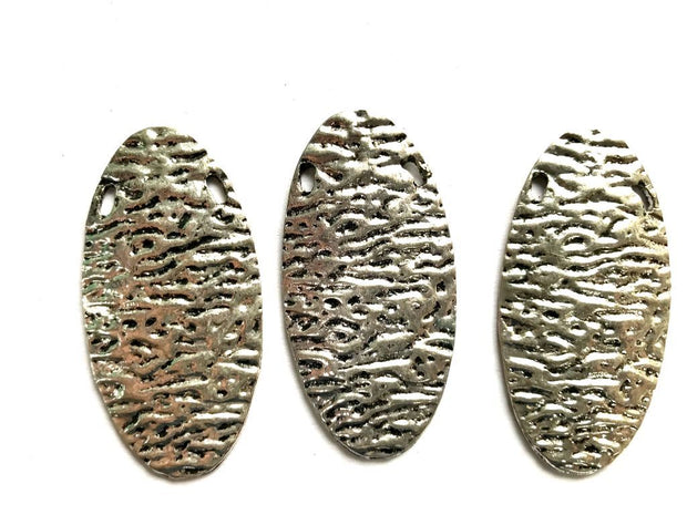 Silver Oval Metal Piece with Texture
