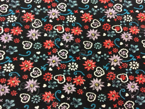 Multicolour Distributed Flowers Design Printed Crepe Polyester Fabric - The Design Cart
