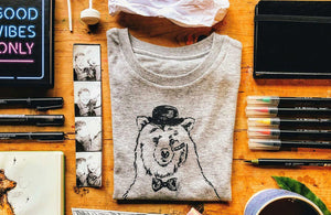 disguise bear t-shirt flat lay photo