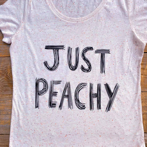 women's scoop neck t-shirt with 'Just Peachy' text
