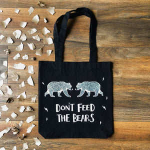 don't feed the bears black tote bag