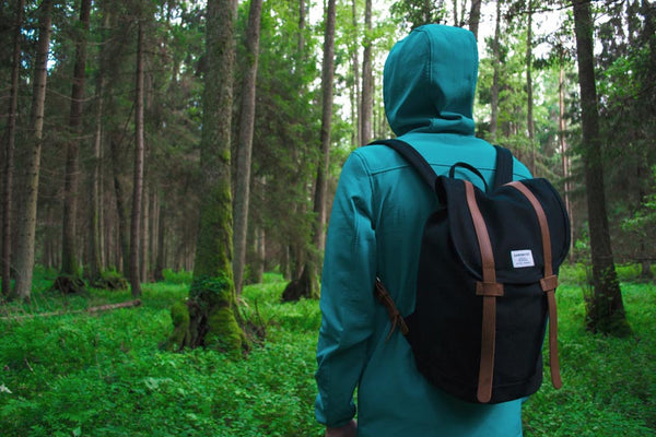 Man with a backpack in a forest