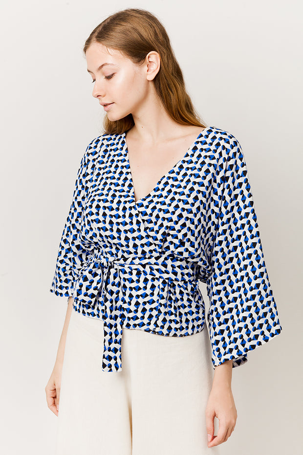 model in blue wrapover kimono top