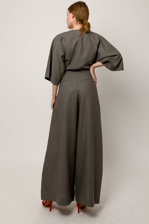 Model in gray wrap pants with front knot - back look