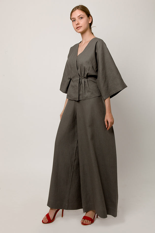 Model in gray wrap pants with back knot