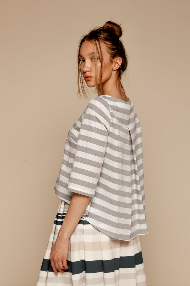 Gray-and-white back-pleat top