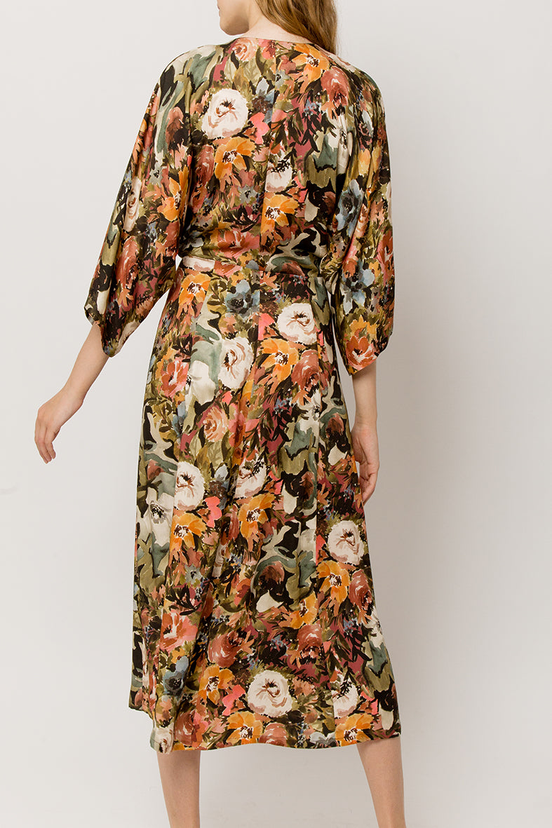 Back look of a long wrap tiche summer dress with flower print