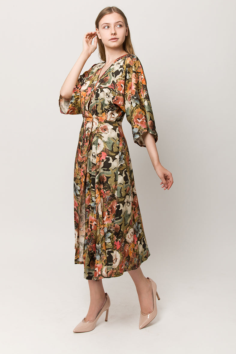 Model with long wrap tiche design summer dress with flower print and a belt
