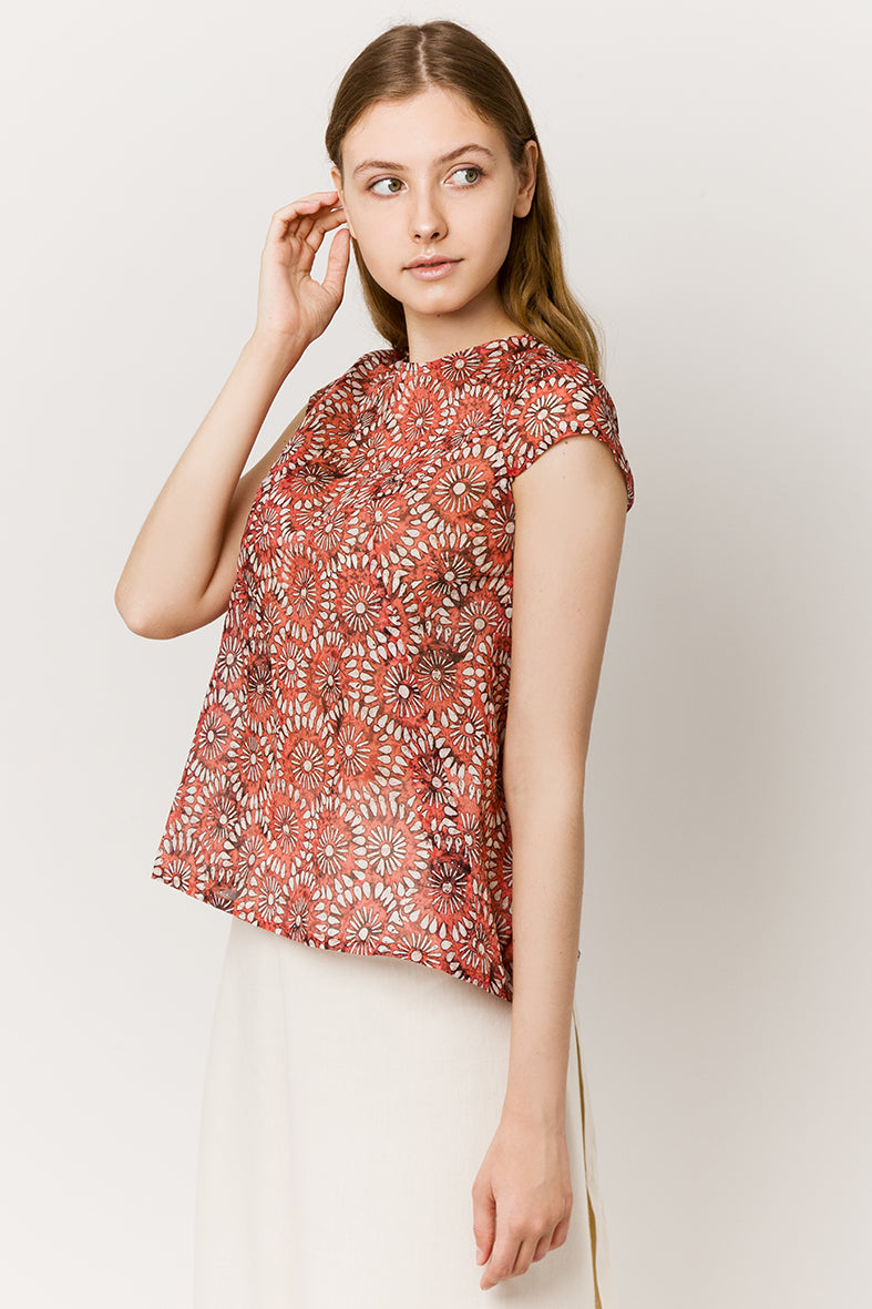 Model in red light cotton top with flowers - side look