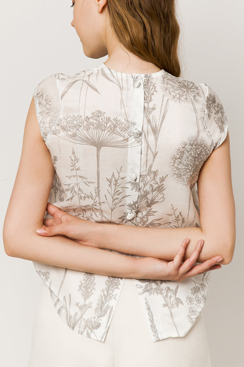 Model in sleeveless silk & cotton top  - back view