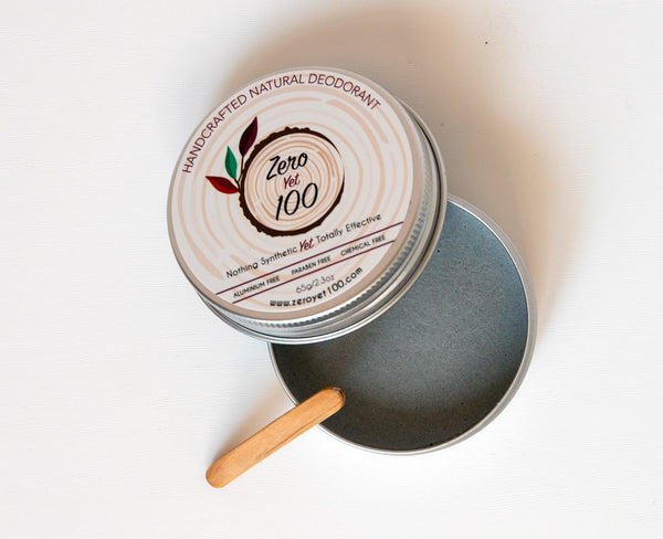 Handcrafted natural deodorant in a metal pot with bamboo spatula