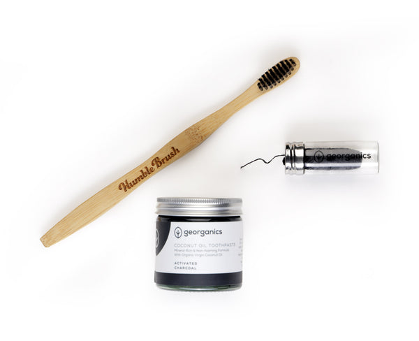 Black bamboo toothbrush, biodegradable dental floss, charcoal toothpaste