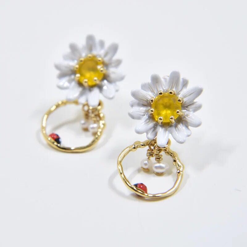 Daisy and gold hoop earrings