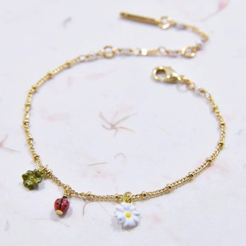 Stunning and delicate daisy and ladybird bracelet