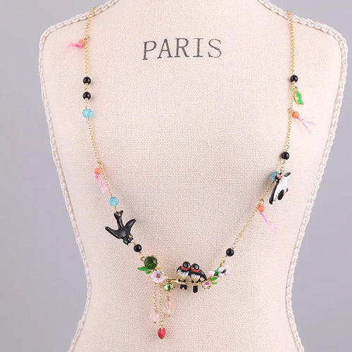 Swallows all around necklace.