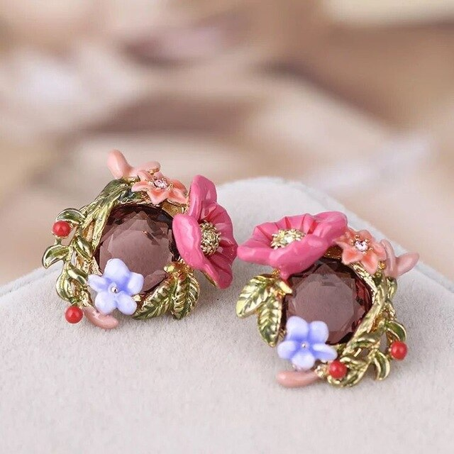 garden inspired earrings around a colourful crystal.