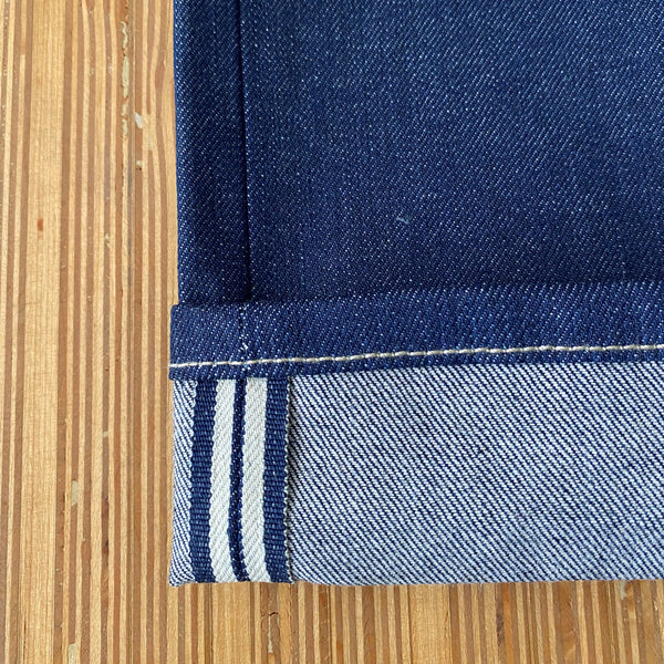 Style J56843 :  13 oz. Cone Deeptone Denim Indigo Comfort Stretch Selvage with Natural Selvage ID