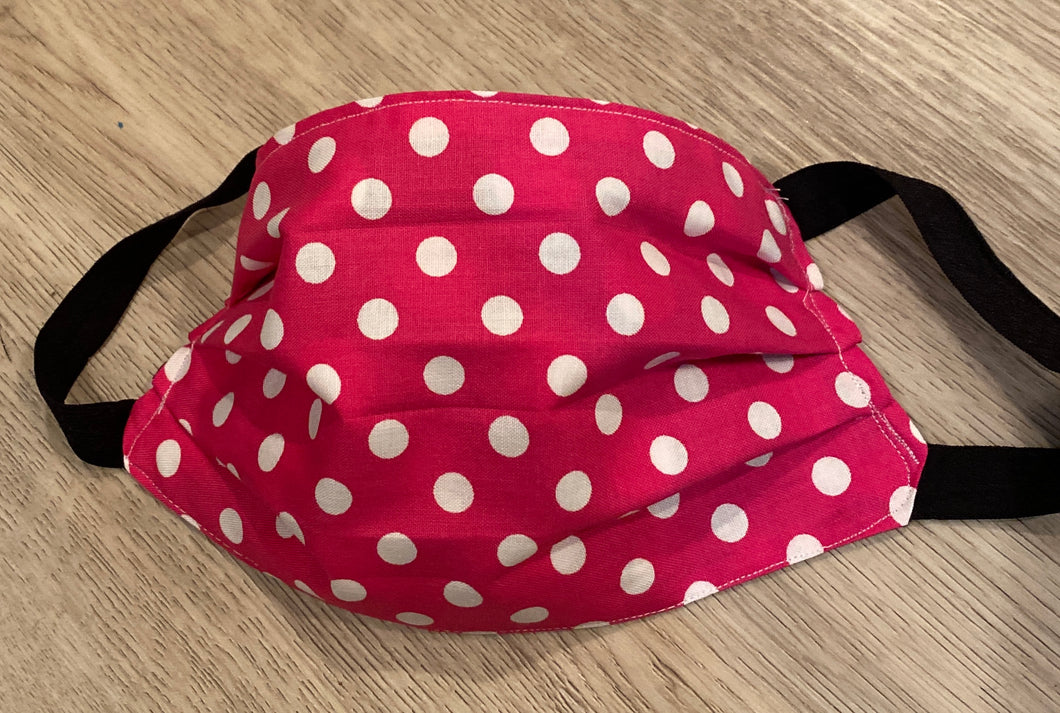 Face Mask is cotton,washable, reversible , handmade,  great for protection in  raspberry polka dot reverses  to black and white polka dot