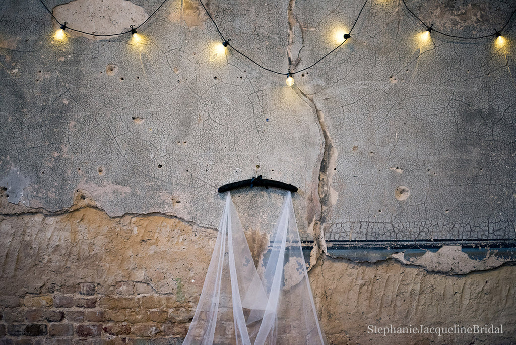 Behind the scenes image of the Serena Bridal Cape at the Asylum chapel