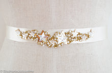 Close up of hand beaded Andromeda star bridal belt