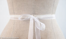 The Astrid organza bridesmaid belt tied in a bow at the back